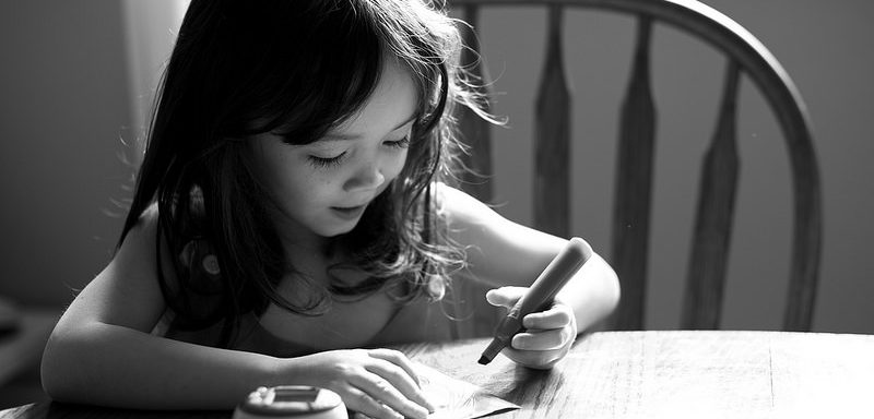 young child writing to illustrate reclaiming our creativity in a blogpost by Yang-May Ooi