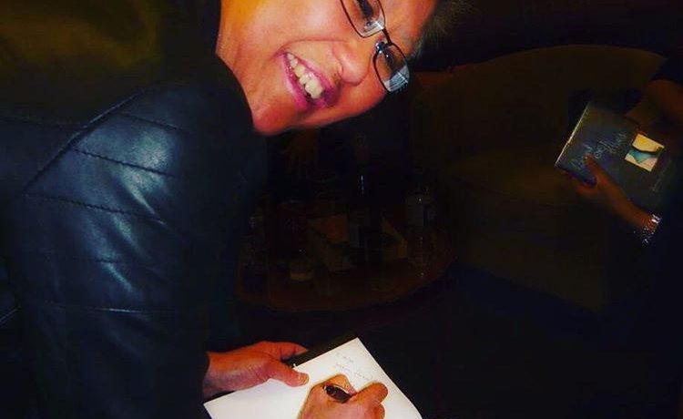 Writer and creative actionista Yang-May Ooi signing her memoir Bound Feet Blues