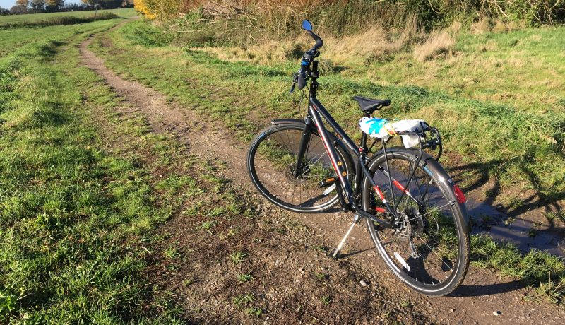 Bicycle in a field - to illustrate Surprised by Sandford Lock by Yang-May Ooi in her blog Oxford Moments