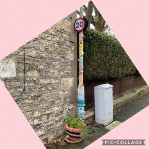 Yarn bomb on lamp post and flower pot to illustrate a post by Yang-May Ooi, Knitwear for Lamp Posts, on the Oxford Moments Blog